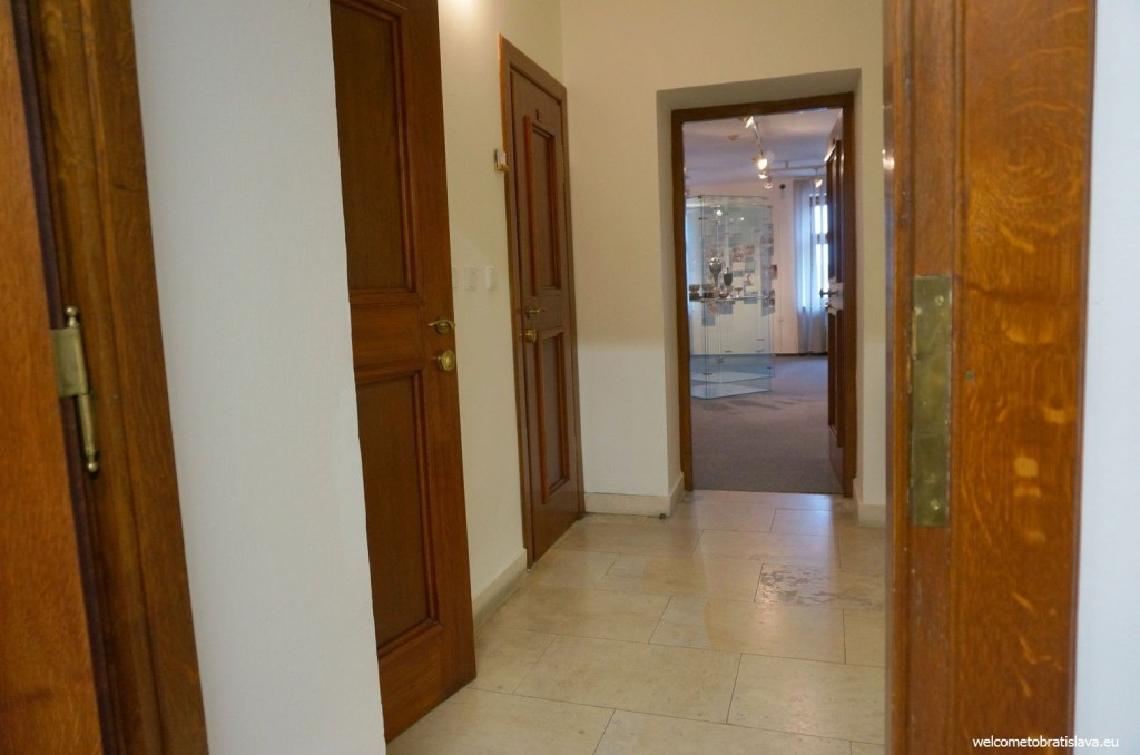 All rooms are quite small, with white walls and wooden doors