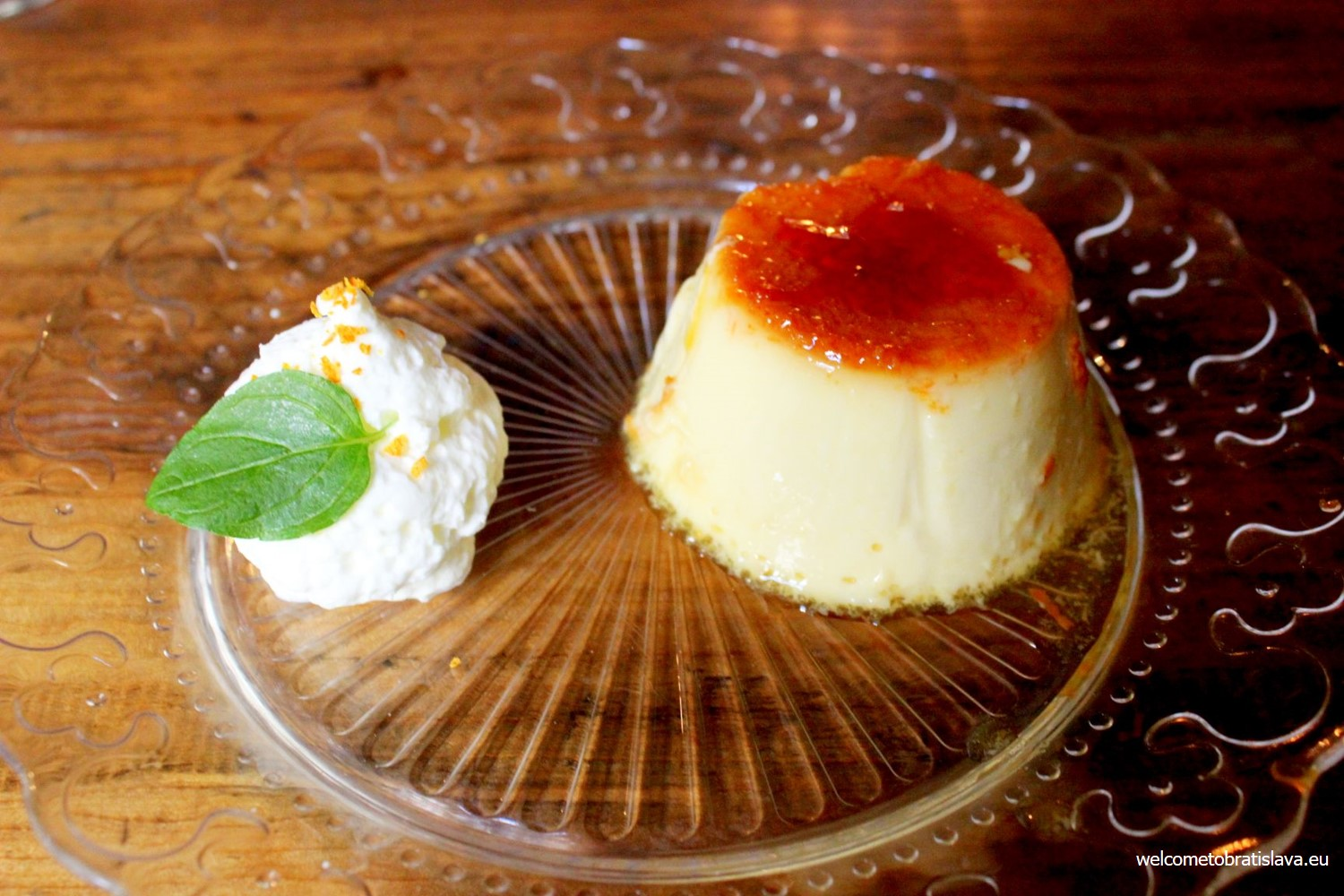 Orange flan with whipped cream