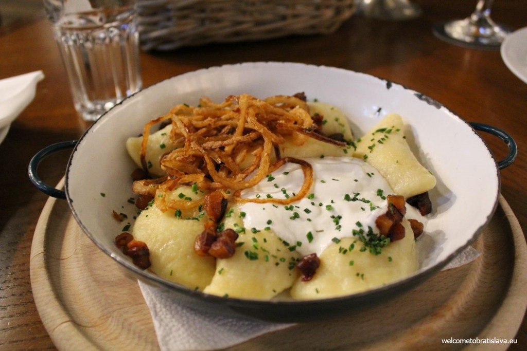 "Mestiansky pivovar: ""bryndzove pirohy"" – potato gnocchi filled with Slovak sheep cheese, sour cream, crispy bacon and fried onion"