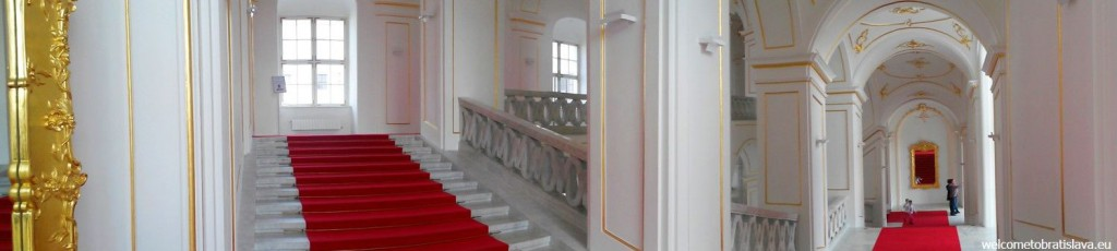 A long red carpet covers all the stairs