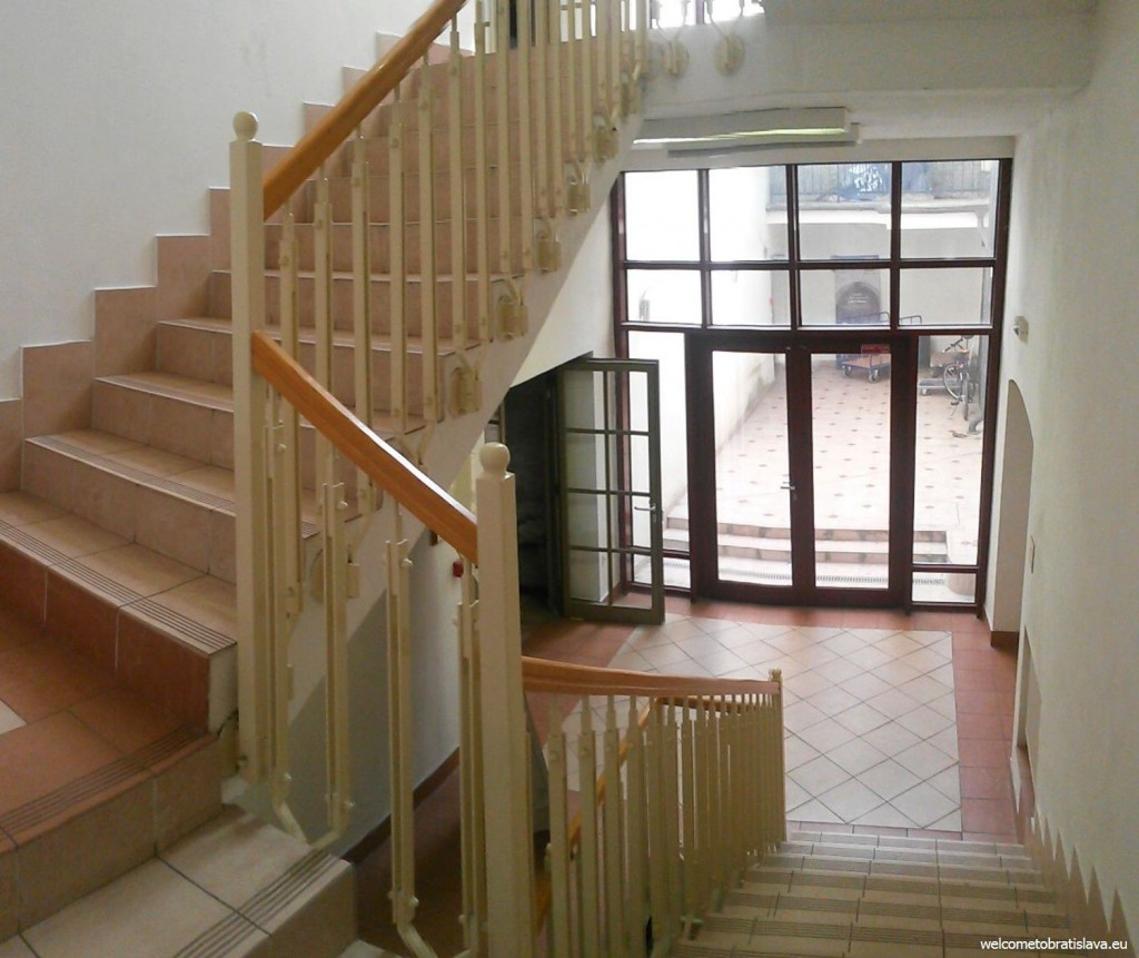 Take the stairs up to the first floor