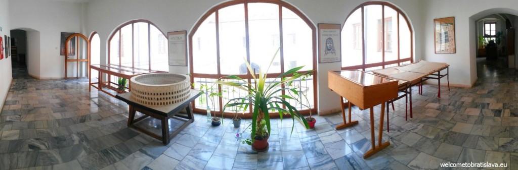 A long corridor with an entrance to an outdoor balcony