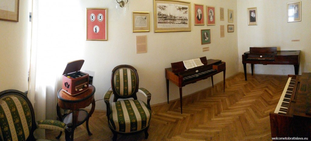 Three historical pianos are exposed in one of the rooms