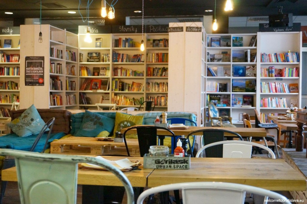 Urban Space: colorful old style chairs, wooden tables, various fur stools
