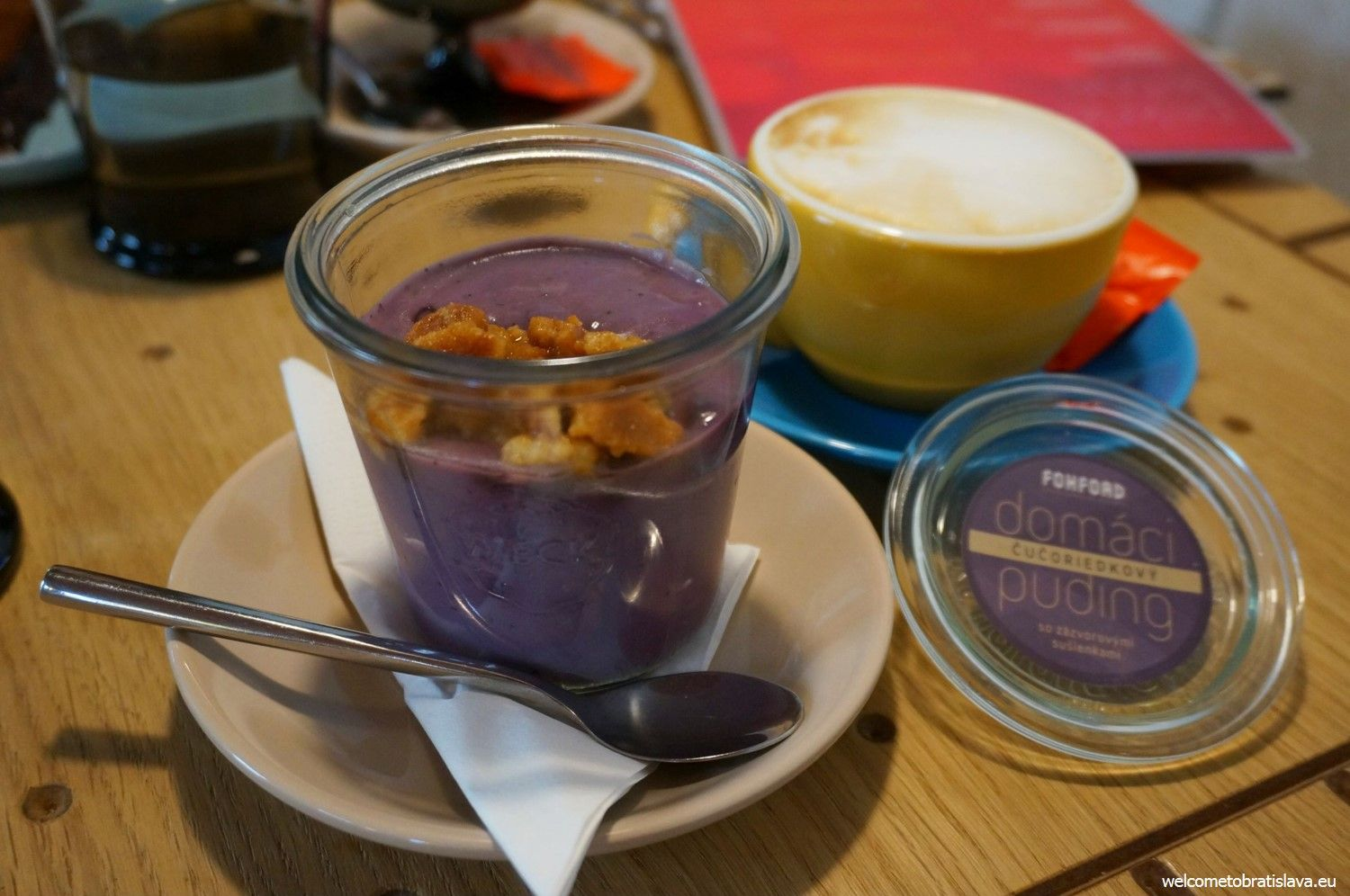 A blueberry pudding with ginger cookies