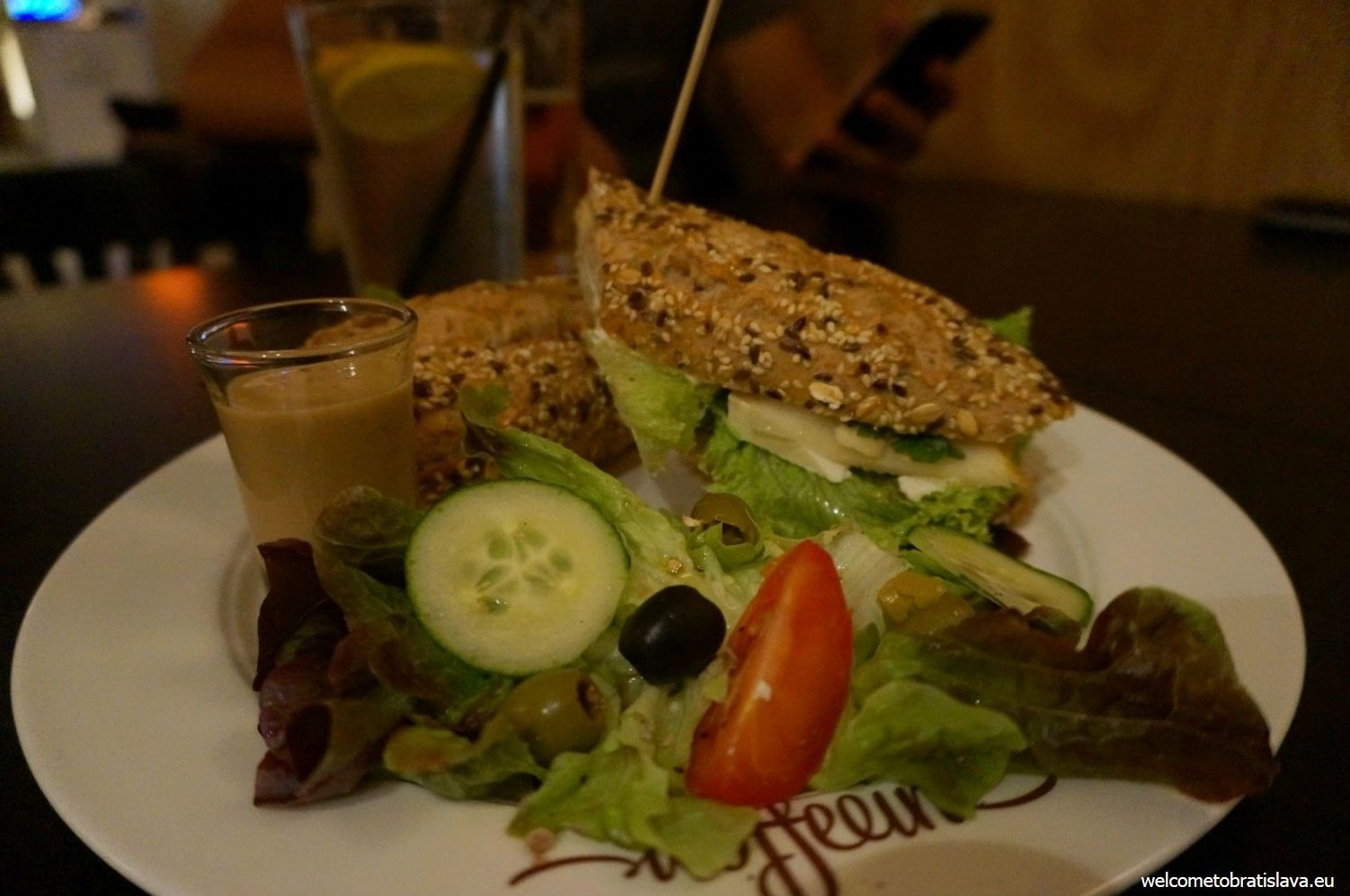 The Chaplin baguette with goat cheese, mixed salad, coriander, almonds and pear slices