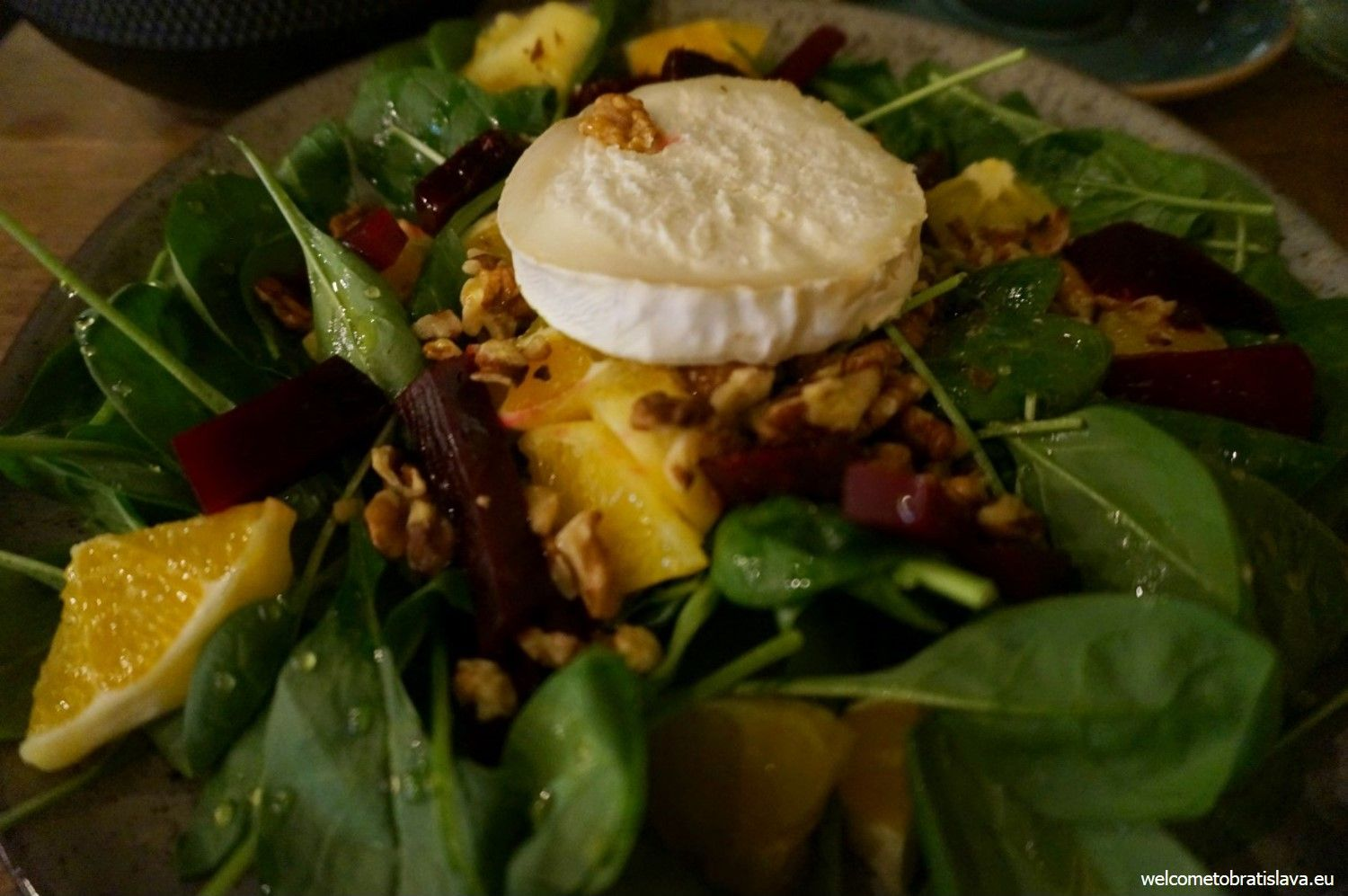 Goat cheese salad with nuts, roast beetroot, baby spinach and honey sauce