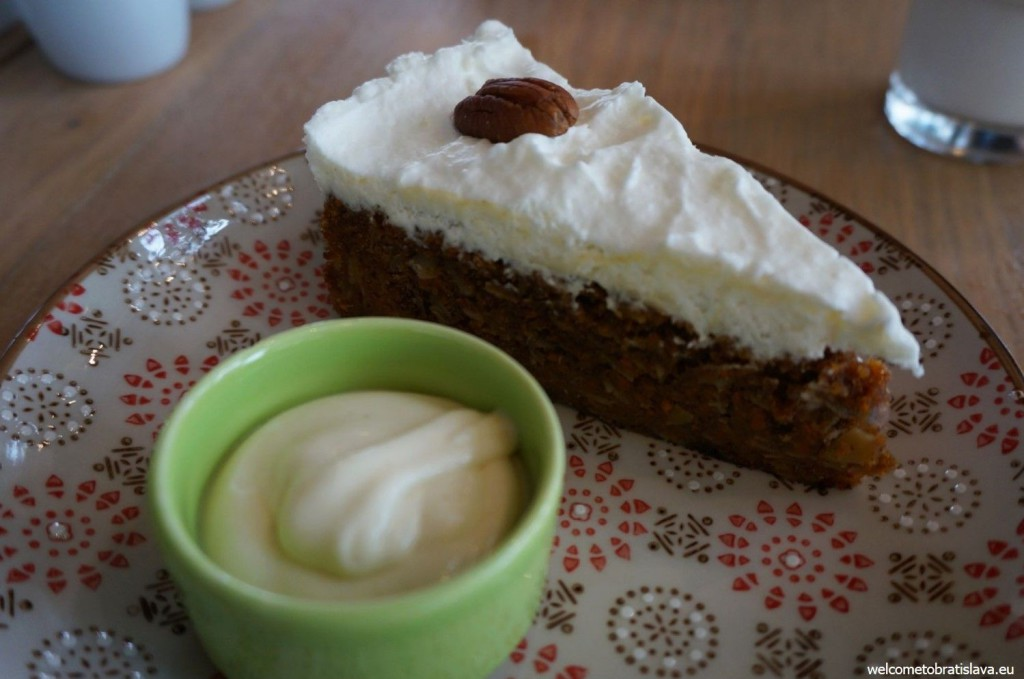 The very best carrot cake with pecans, served with a coconut pudding