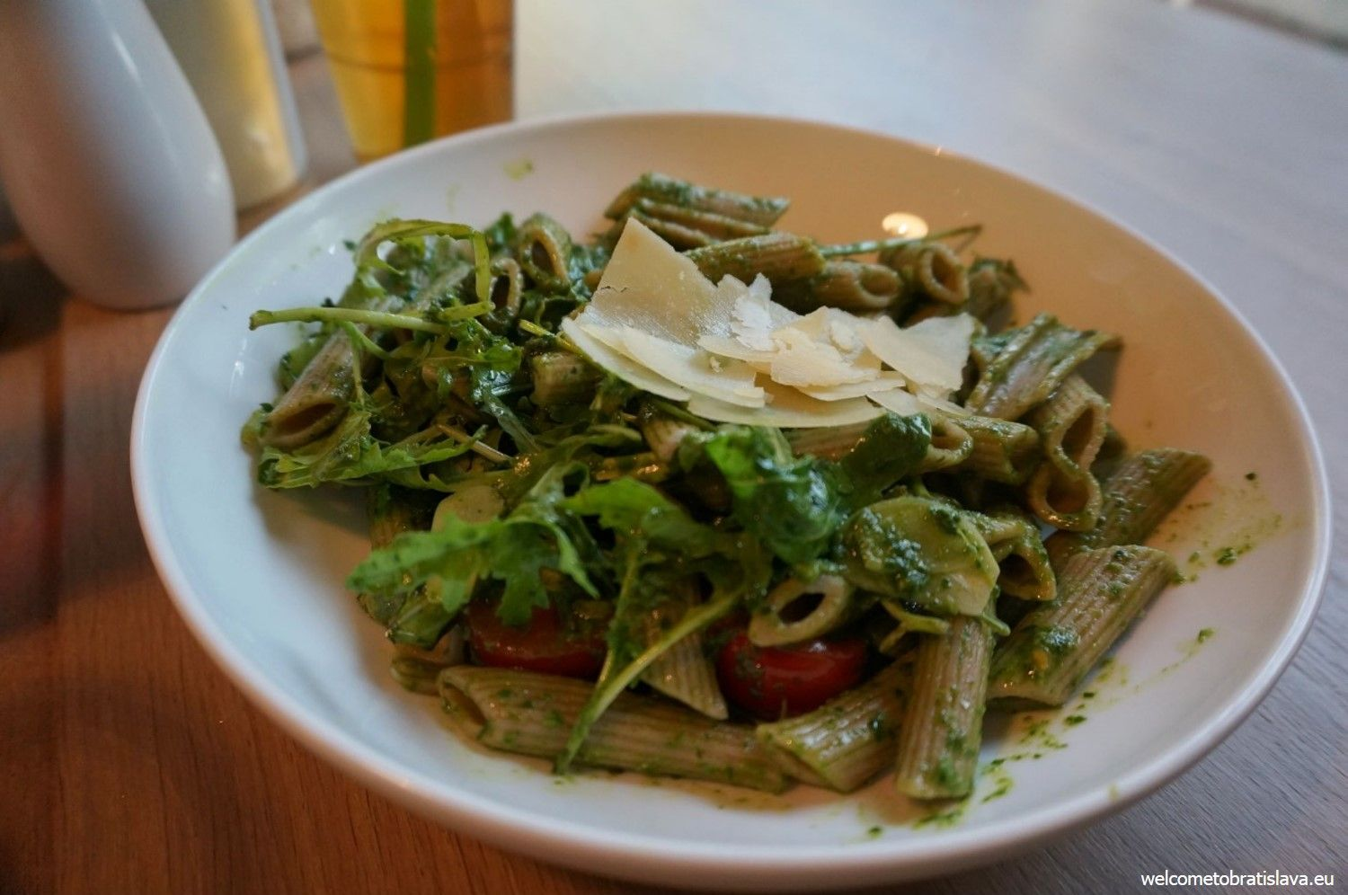Penne with basil pesto, cherry tomatoes, rucola and Parmesan