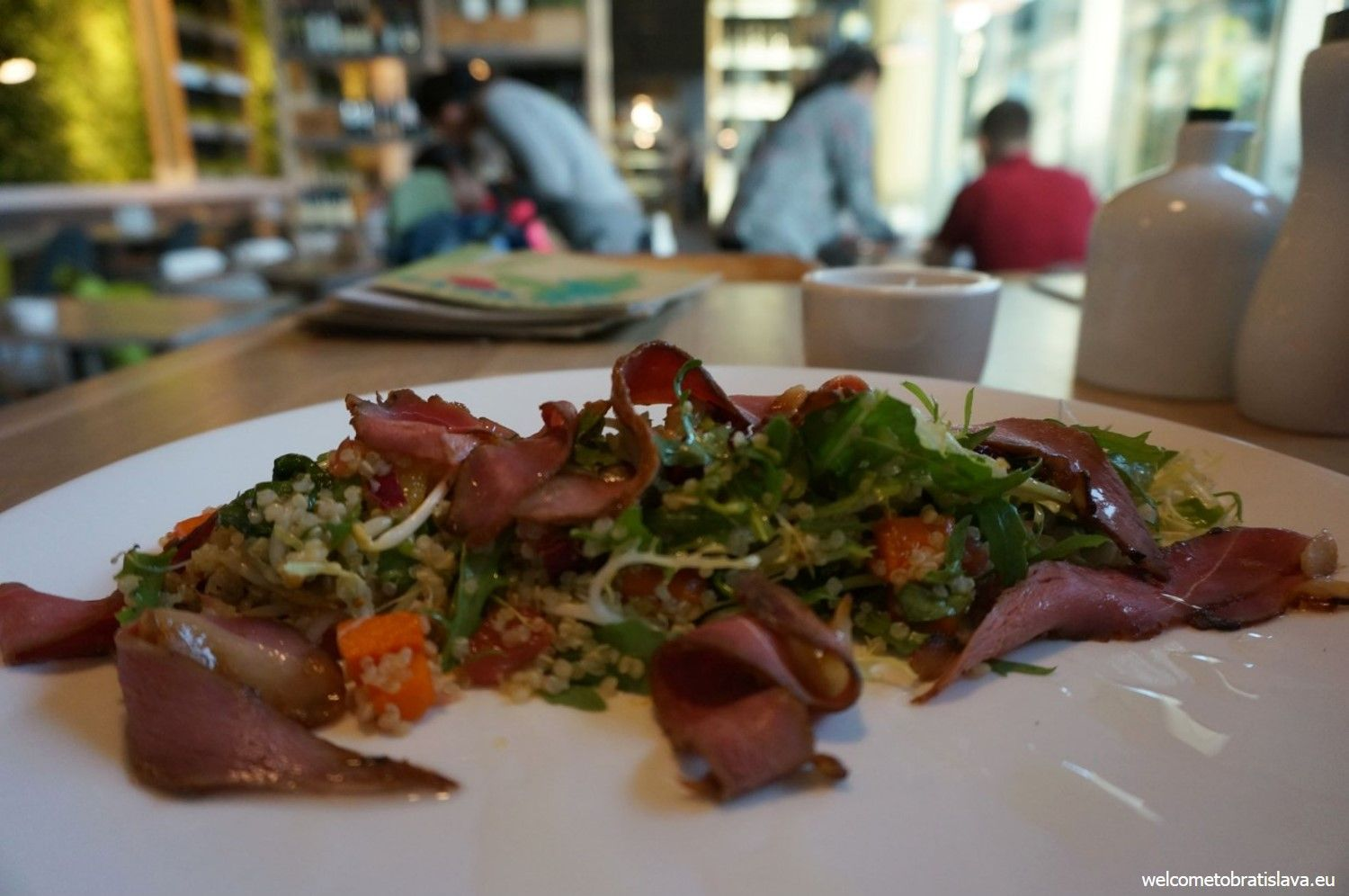Salad with marinated duck, quinoa, roasted pumpkin, sprouts, grapefruit pulp and citrus dressing