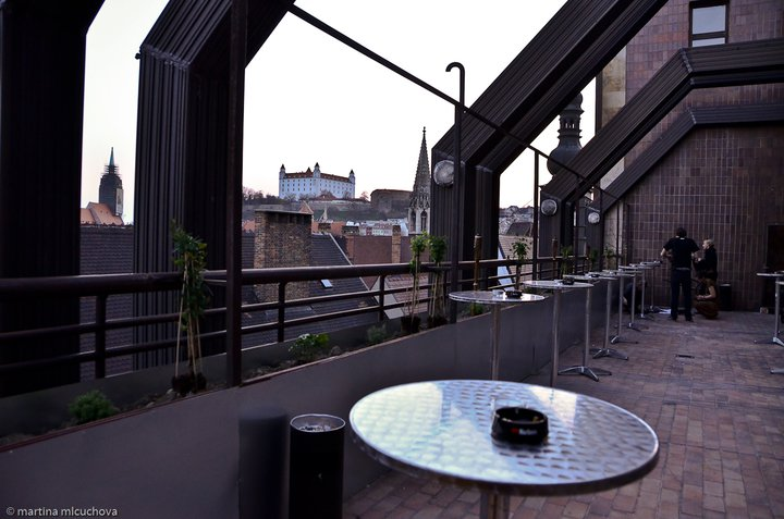 The main bar part has a summer terrace and a great view on the Old town.
