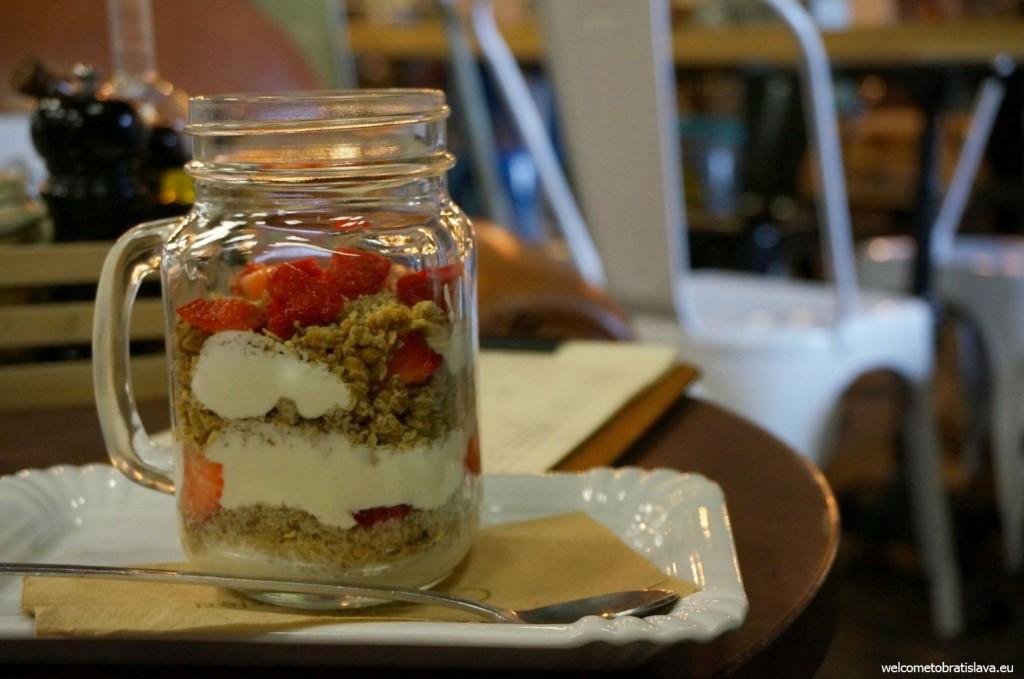 Granola with thick Greek yogurt and fresh strawberries