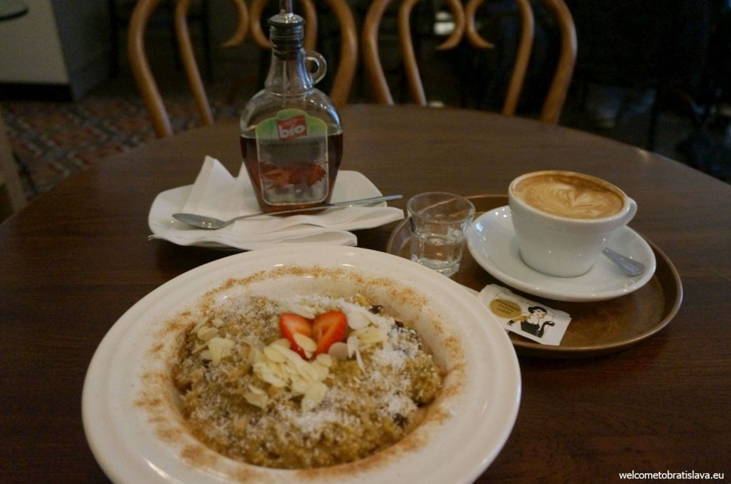 The healthy millet porridge with coconut cream, prunes, banana, maple syrup, cinnamon and almonds