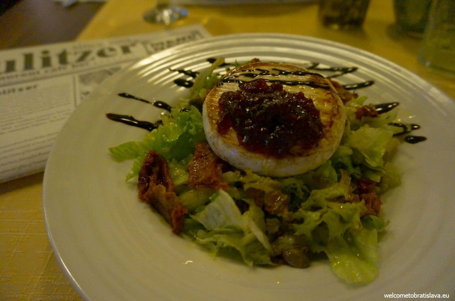 """Probably the most delicious meal I have had in Pulitzer so far is the """"Pulitzer salad"""" which is served with grilled noble white mold hermelin cheese, green salad, sun-dried tomatoes, capers and cranberries."""
