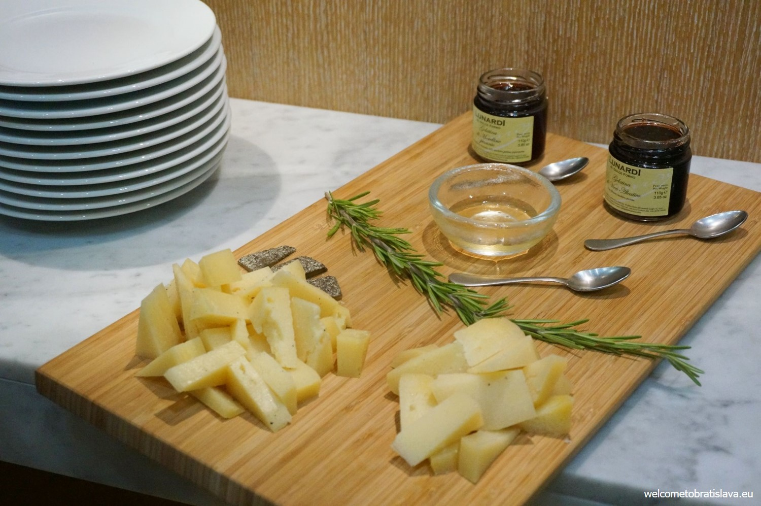 A selection of cheeses with jellies and honey