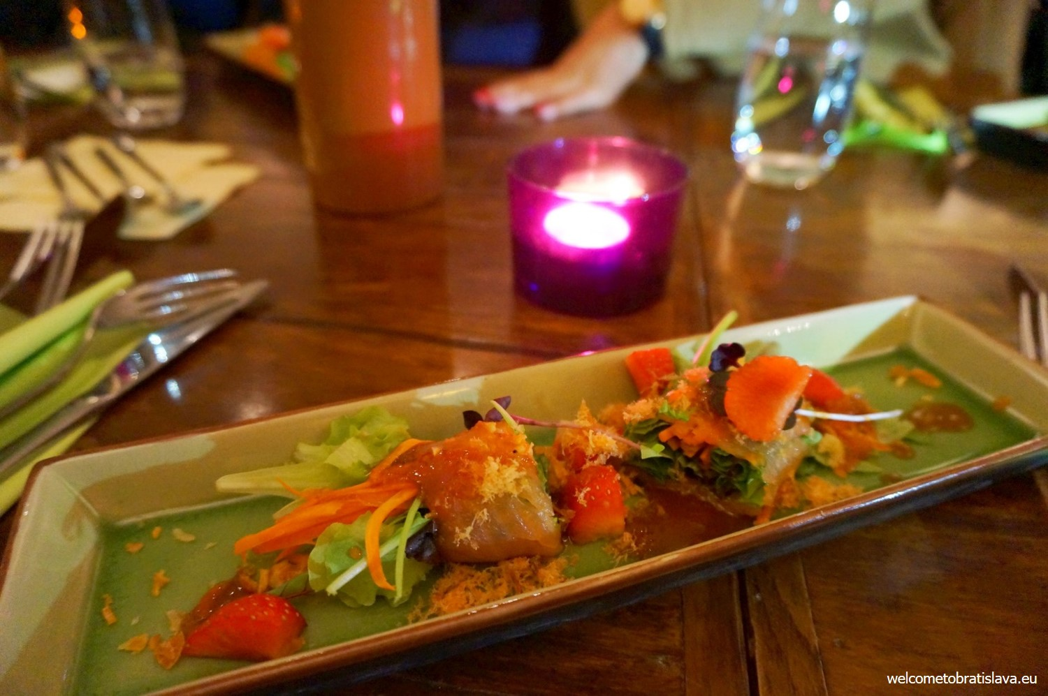 Smoked salmon rolls served with herbs, strawberries and tom yam honey