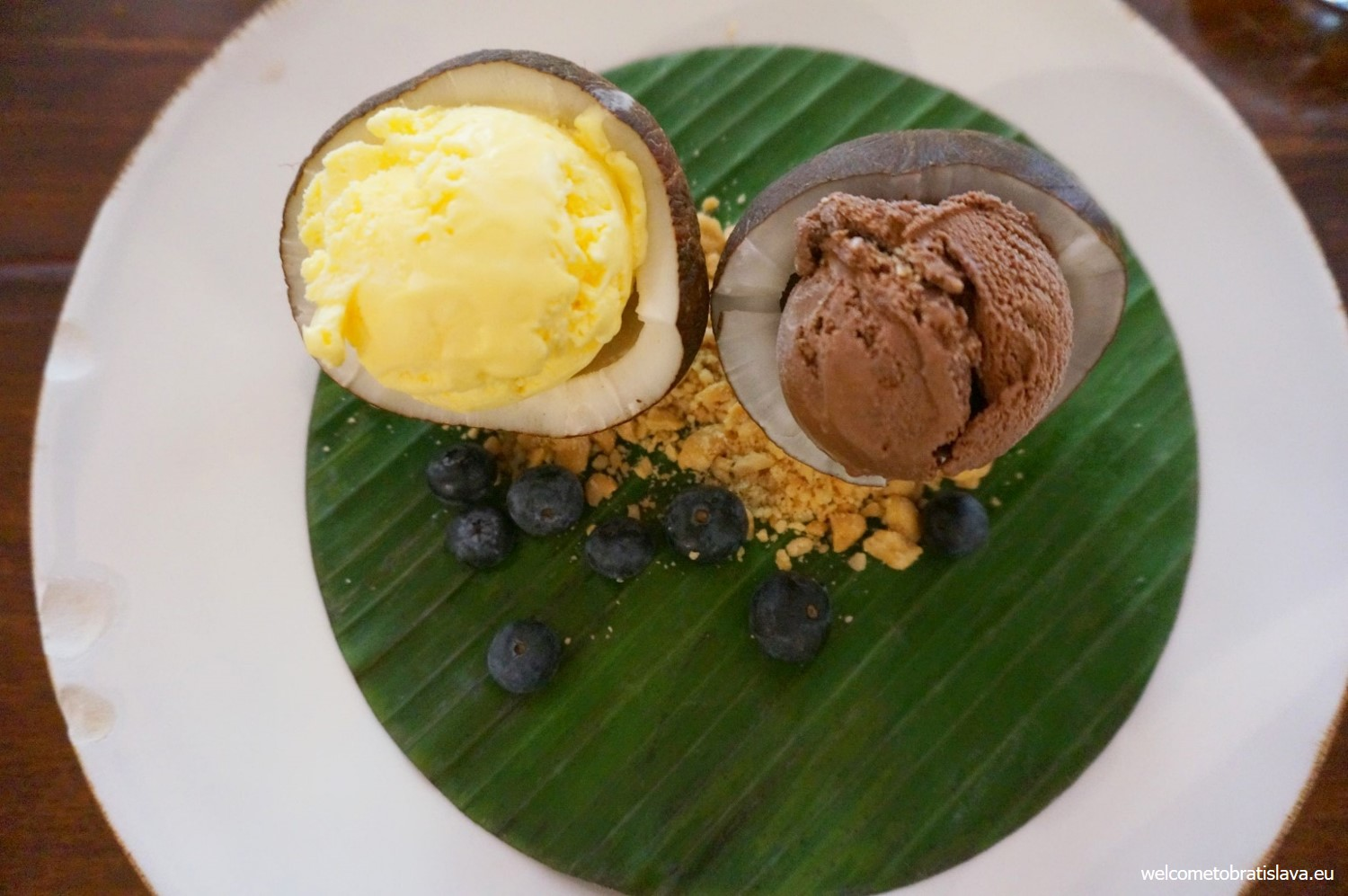 Ice cream with fresh fruit served in coconut halves