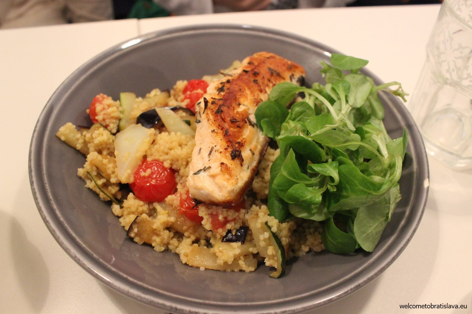 Grilled salmon with millet and grilled vegetables