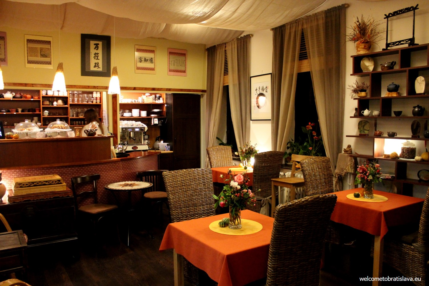 The interior of Čaj Kafé is furnished with wooden and bamboo furniture in natural color tones and complimented by several original ancient Chinese accessories.
