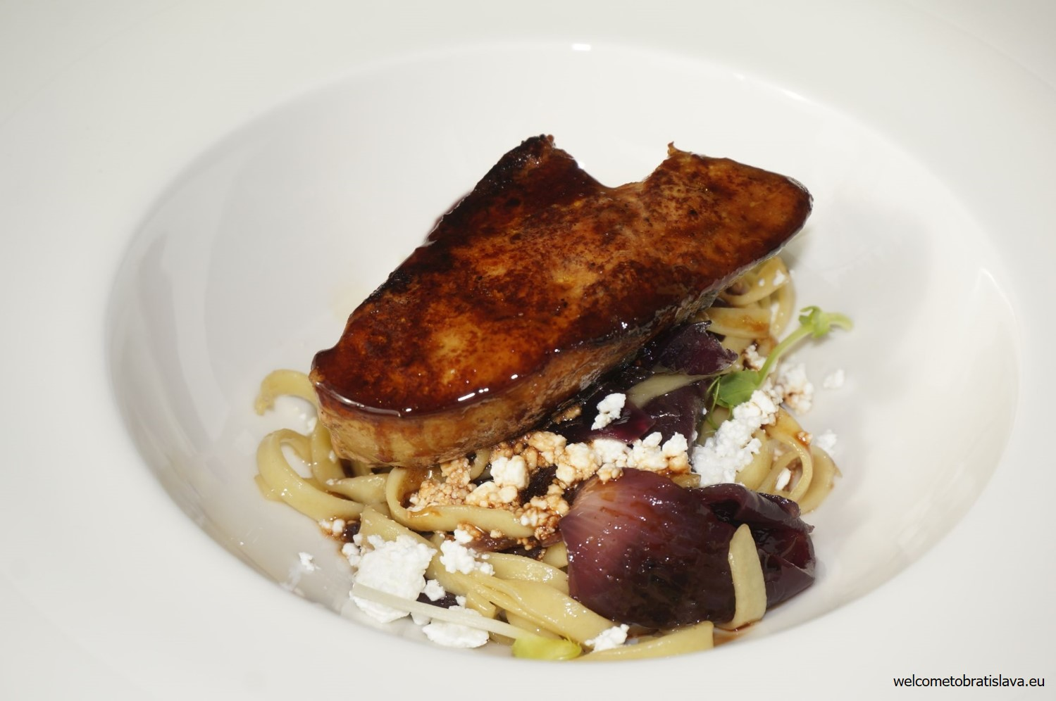 Grilled duck foie gras, curd cheese tagliatelle with caramelized shallot and thyme sauce