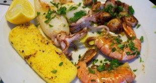 A selection of fresh sea food served with polenta